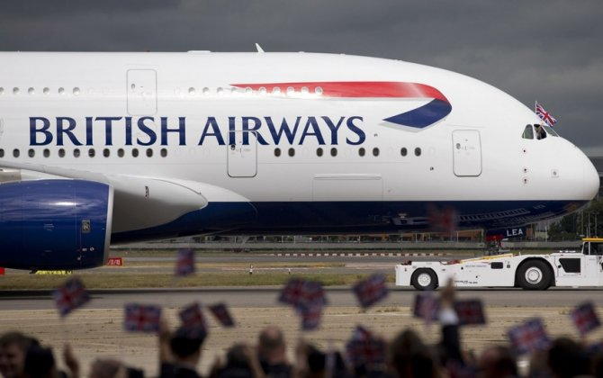 British Airways owner says Brussels bombs, Brexit clip sales