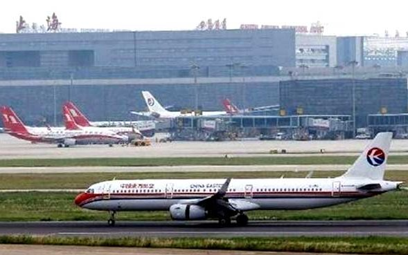 China punishes air traffic controllers for near miss in Shanghai