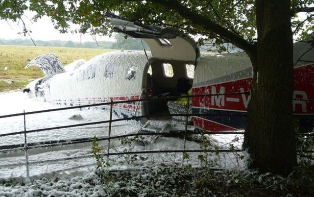 Pilots 'lucky escape' after brand new private jet crashes into field next to airport