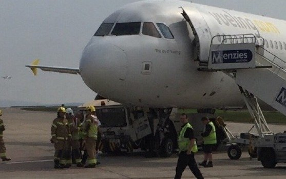 Plane crushes tow truck